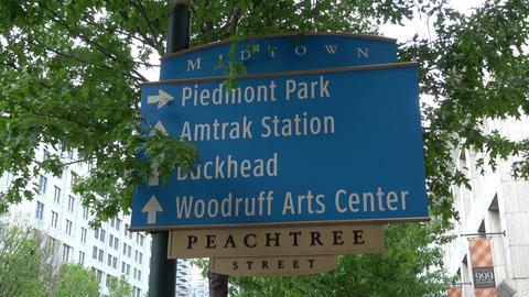 Direction signs on Peachtree Street Atlanta Midtown - ATLANTA / GEORGIA - APRIL  Live Action