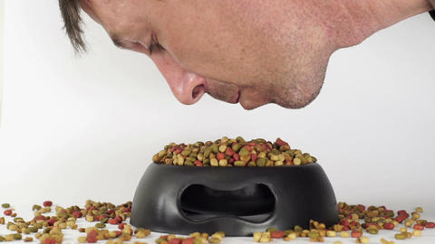 Man Eating Pet Food From Dish Footage