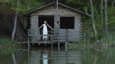 Girl In The House By The Lake In The Morning Footage