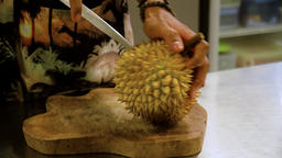 man trying to peel Durian Footage