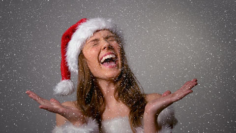 Video composition with falling snow over happy girl in santas suit Animation