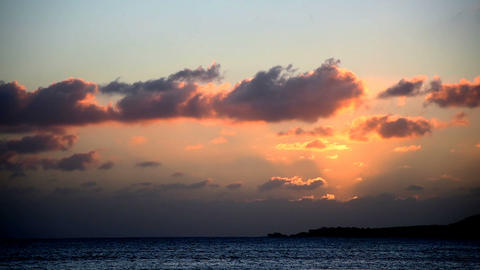 Orange sky with clouds over the sea at sunset Footage