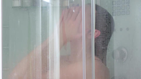 Girl washes her head in shower Footage