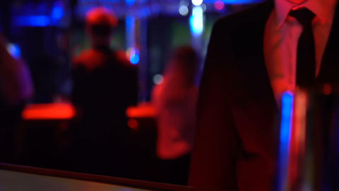 Night club customer ordering alcohol shot on bar, businessman at party event Live Action
