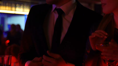 Young couple drinking alcohol and dancing to music, youth leisure on weekend Footage