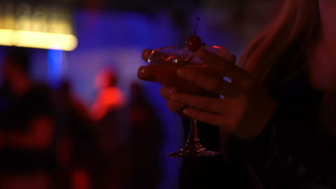 Glamorous young lady drinking cocktail at luxury lounge bar, night life leisure Footage