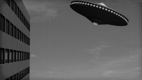 Vintage Alien Invasion: Flying Saucer crashes into a Building GIF