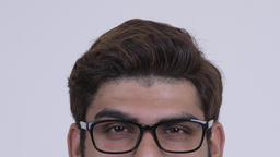 Eyes of young Indian hipster man with eyeglasses thinking Footage