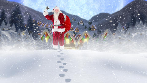 Santa clause in front of decorated houses in winter scenery combined with falling snow Live Action