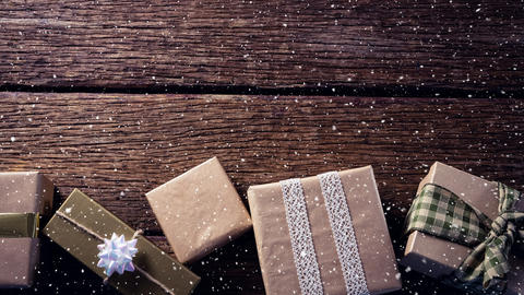Falling snow with Christmas gifts decoration on wood Animation