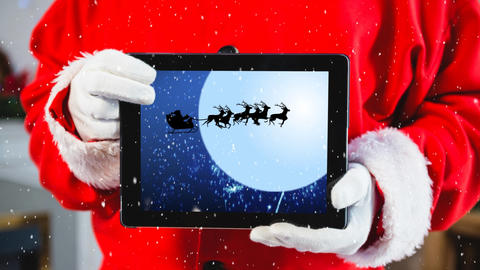 Video composition with snow over torso of santa holding tablet Animation