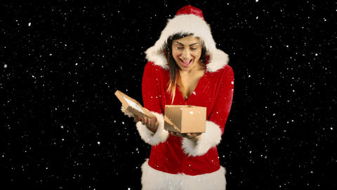 Video composition with falling snow over happy girl in santas suit opening gift box Animation