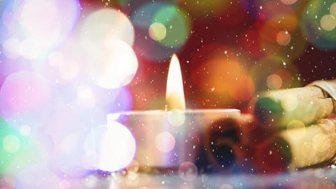 Candle and cinnamon combined with falling snow Animation