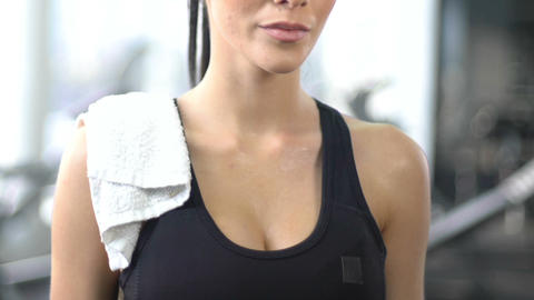 Sweating woman with towel on shoulder after tough workout, fitness lifestyle Footage