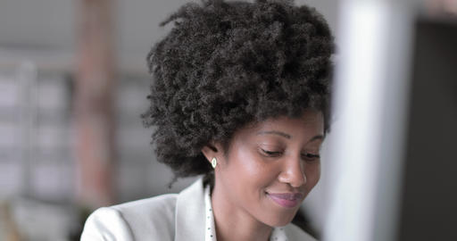 Female african american business executive working in an office on a desktop Live Action