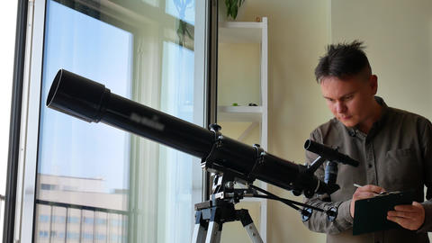 Man looking at the stars with telescope Footage