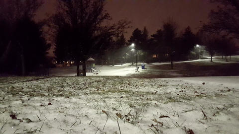 Snowy Night in the Park Along Playground. Beautiful Evening Snowing View. Night Footage