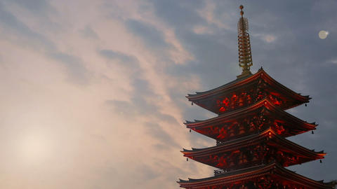 Pagoda against the evening sky and moving clouds. Time lapse GIF