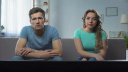 Couple in conflict watching tv silently ignoring each other, relationship crisis Footage