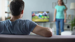Woman quarreling, man watching football match, ignoring conflict, relationship Live Action