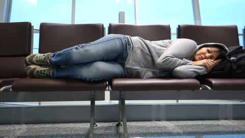 Attractive woman sleeping at the airport Footage