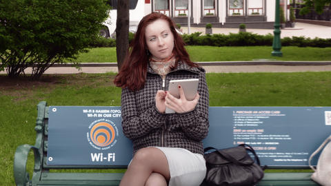 4K Girl Browsing Internet With Electronic Tablet Footage