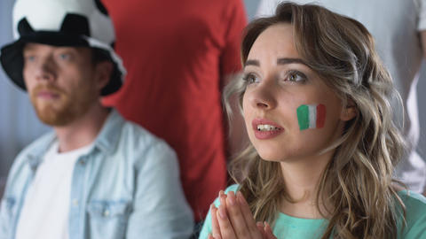 Italian supporters watching game on tv, shouting and supporting national team Live Action