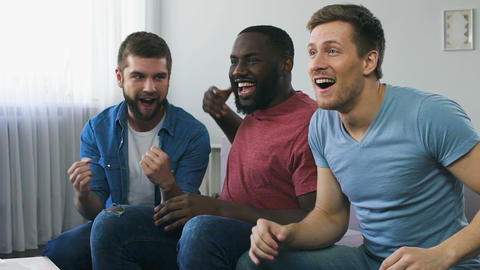 Fans expressing great happiness because of victory of favorite sports team Live Action