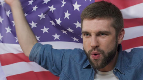 Man waving american flag, celebrating victory of presidential candidate, slow-mo Footage