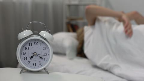 Loud alarm clock signal waking up sleeping couple in… Stock Video Footage