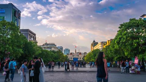 Time lapse of Nguyen Hue walking street at dawn GIF