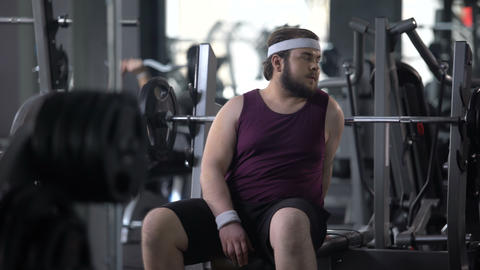 Tired fat man having rest after workout exercise, strength of muscles, training Live Action