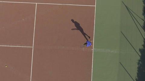 Sportive man training on tennis court, worldwide popular sport, top view Live Action