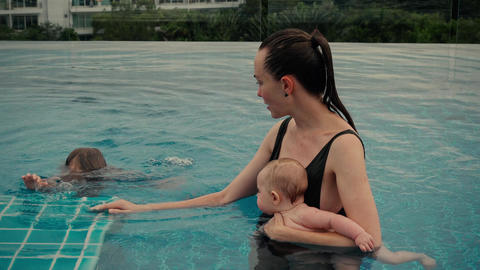 Woman with children in pool Footage