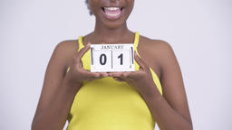 Young happy African woman holding calendar block ready for New Years Archivo