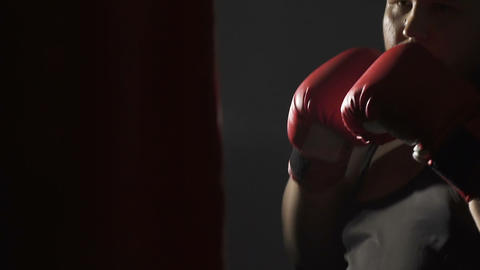 Heavyweight athlete boxing with punching bag, imagines opponent, martial arts Footage