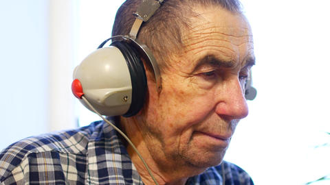 Hearing test. Man with headsets listen to a noise. Occupational health and Footage
