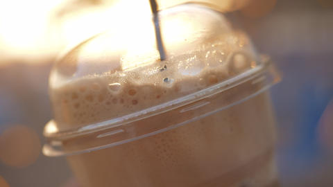 Takeaway cold coffee with straw Live Action