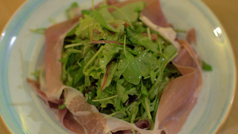 Mix green salad with prosciutto Footage