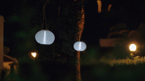 Garden with white Chinese lanterns at night Live Action