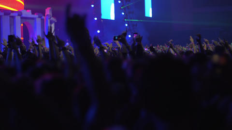 Happy and excited audience dancing at the concert Footage