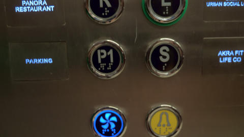 A closeup of hotel elevator buttons Live Action