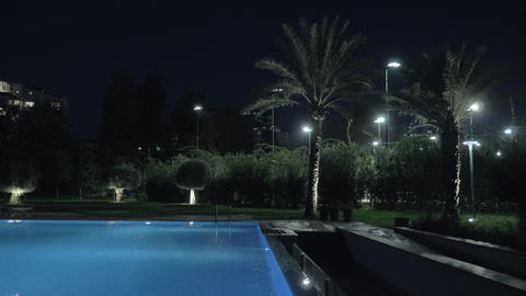 Night view of outdoor swimming pool Live Action