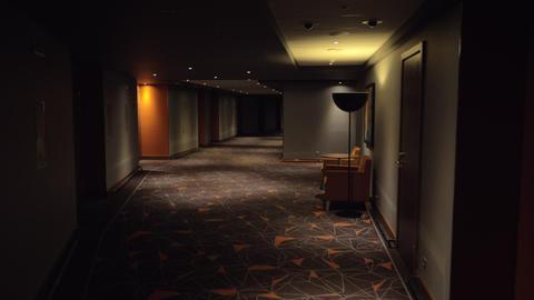 Walking in hotel hallway with dim light Footage