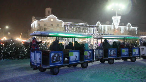 Children's walking train taking for a drive children during New Year holidays Live Action