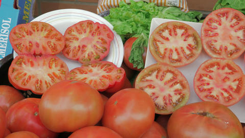 Tomatoes and lettuce on greengrocer counter Live Action