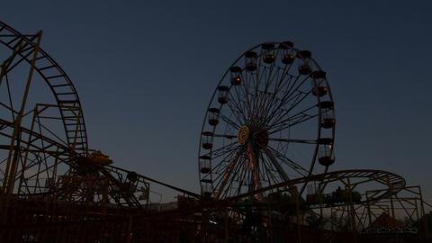 Amusement park at sunset Live Action