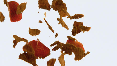 Corn flakes and strawberries falling against white background 4k Live Action