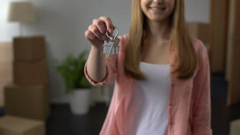Woman showing key from apartment, affordable lending, investment in real estate Footage