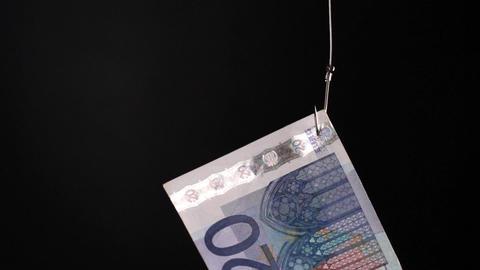 euro on fishing hook Stock Video Footage